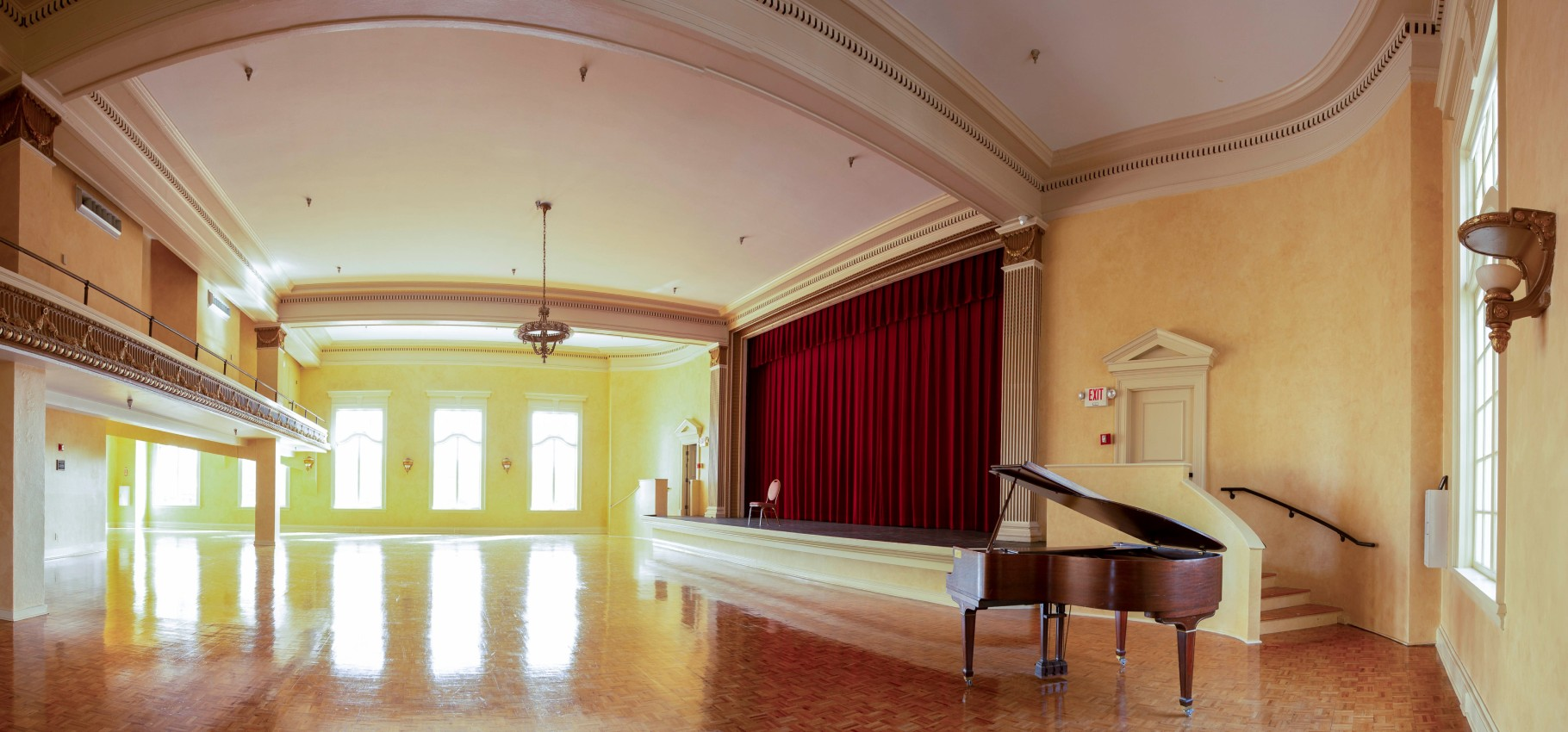 open hall with piano and stage
